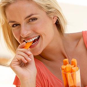 Skopek Orthodontics woman eating healthy food for good oral health
